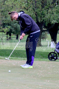 D-NH's Morgan Weber took extra time to clear her line of debris on some of the soggy greens in Ames. (Jake Ryder photo)