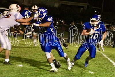 Dike-New Hartford's Cade Bennett (30) cuts to the outside of his teammates blocking the way, including Tristan Cleveland (40) in a second-quarter touchdown run at Dike on Friday. (Jake Ryder photo)