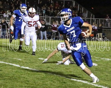 Dike-New Hartford's Drew Sonnenberg heads toward the Wolverine sideline on a run in the first half of Friday's playoff win against South Hamilton. (Jake Ryder photo)