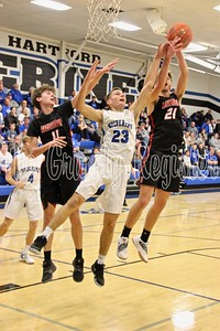 Dike-New Hartford's Derek Kinney (23) gets a hand in to deflect a rebound away from Union during last Friday's game in Dike. (Jake Ryder photo)