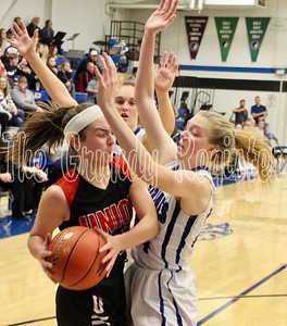 Dike-New Hartford's Katie Knock (right) and Jill Eilderts trap a Union player on the baseline during last Friday's game in Dike. (Jake Ryder photo)