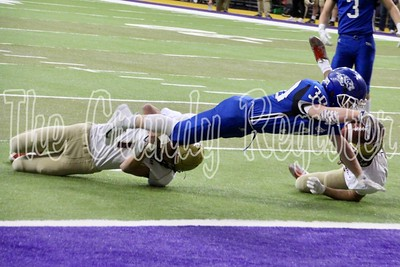 Dike-New Hartford's Cade Bennett lunges for the goal line for a Wolverine touchdown in the first quarter of Saturday's game with Pella Christian in the UNI-Dome. (Jake Ryder photo)