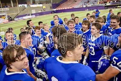 Dike-New Hartford football breaks the huddle after winning a Class 1A state semifinal against Pella Christian on Saturday. (Jake Ryder photo)