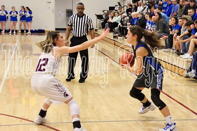 Grundy Center's Hailey Wallis (left) gets a hand up in the face of Gladbrook-Reinbeck's Reagan Skovgard last Friday. Wallis said defense is an important part of contributing to the Grundy Center offense, as the Spartan senior passed 1,000 career points in the 76-23 win against the Rebels. (Jake Ryder photo)