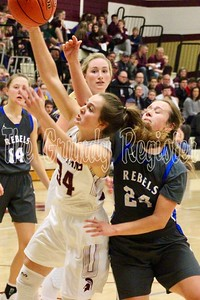 Grundy Center's Kylie Willis (34) and Gladbrook-Reinbeck's Rachel Cooley battle for a rebound under the basket during Friday's game in Grundy Center. (Jake Ryder photo)