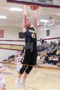 BCLUW's Jonny Neff delivers the two-handed slam dunk during Saturday's game with Grundy Center. (Jake Ryder/Mid-America Publishing)