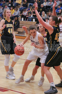 Grundy Center's Cora Saak backs her way into the paint as a trio of BCLUW girls converge on her during Saturday's game in Grundy Center. (Jake Ryder photo)