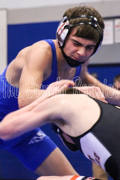Dike-New Hartford's Jace Petersen keeps West Delaware's Daniel Woods at bay during their 138-pound match on Saturday in Reinbeck. (Jake Ryder photo)