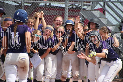 AGWSR's Rachel Sicard (11) approaches a waiting group of Cougars surrounding home plate after Sicard's homerun against Akron-Westfield in a state semifinal. The Cougars were state runners-up, falling to Collins-Maxwell in the state championship game.