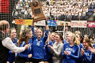 Gladbrook-Reinbeck's Meriah Wittgreve hoists the state quarterfinalist trophy in the air after G-R's straight-set loss to Janesville in Cedar Rapids. The Rebels were making their first state appearance in 30 years.