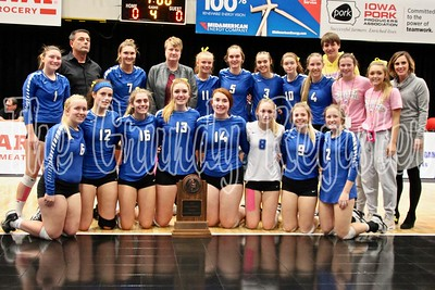 The Dike-New Hartford volleyball team poses with its state quarterfinalist trophy at the U.S. Cellular Center in Cedar Rapids. The Wolverines qualified for the state tournament for the 12th-consecutive season.