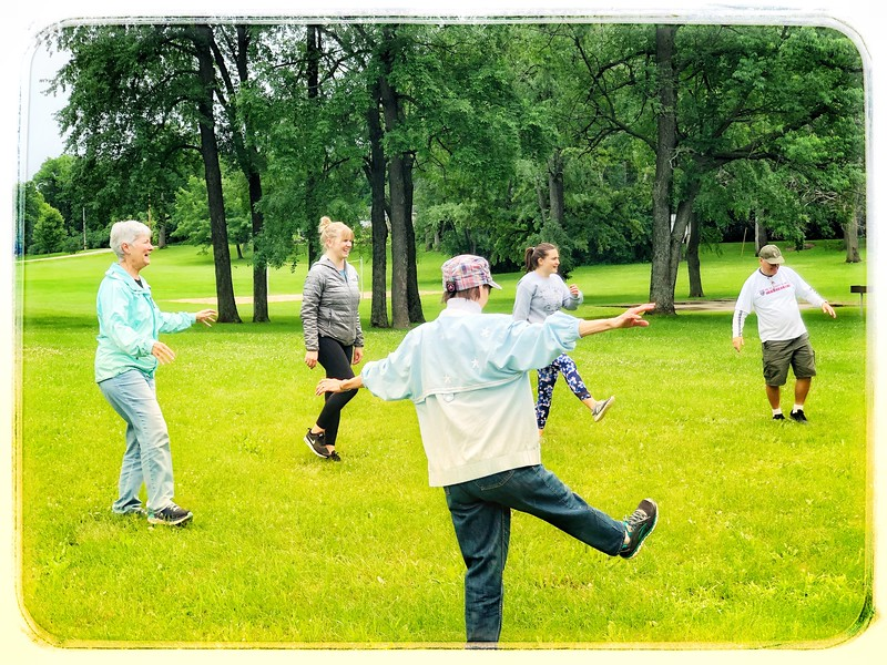 Mary leads the group in some Tai Chi