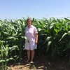 "New picture of Janet showing how tall the corn was the week after...it was only about 10""s when we arrived"