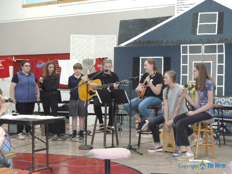 "The eighth grade students sang and played ""Forever Country,"" a song of farewell and well wishes from their class to everyone. (<i>The Mirror</i>)"