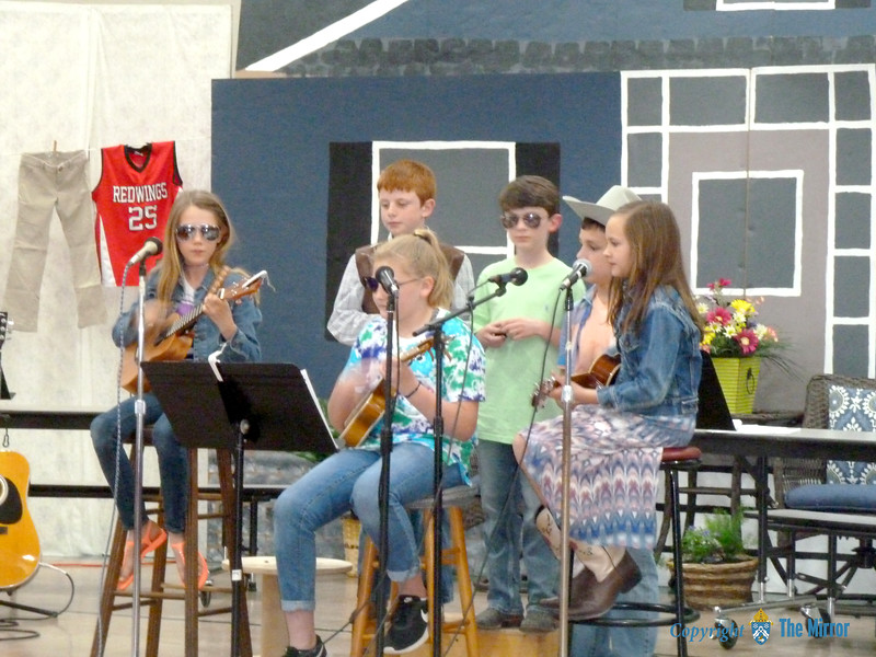 """Happy"" was sung and played by the fourth grade class. Pictured are Ava Forehand, Cooper Bryant, Cora Woods, Reid Hobbs, Ryder Siebert, and Amelia LeGrand. (<i>The Mirror</i>)"