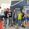 "Fifth and sixth grade students sang ""Thunder,"" with Nolan Loper on the drum. (<i>The Mirror</i>)"
