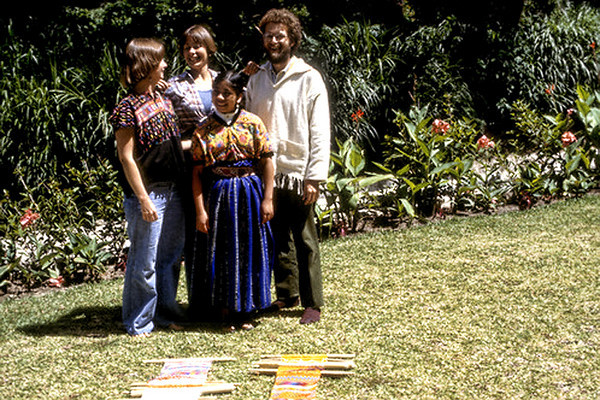One of our Mayan instructors shown in this photo.  That's my backstrap loom/weaving on the left (on the ground.
