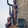 Statue atop a fountain.