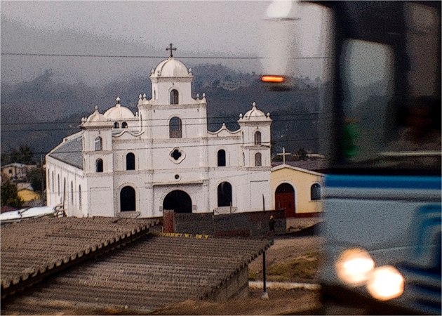 'Drive-by-shooting' from our minibus. Note the big bus entering the picture from the right. Local parish church shot as we head to Lake Atitlan.