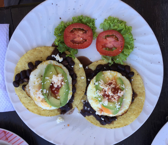 Nice local breakfast - black beans with egg and avocado on hard corn tortillas - excellent!