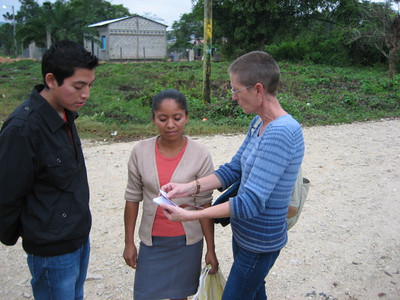 Henry and Beth sharing the gospel with a passer-by on the street.