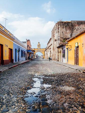 Cobblestone street and the Santa Catalina Arch in Antigua, Guatemala