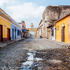 Cobblestone street and the Santa Catalina Arch in Antigua, Guatemala