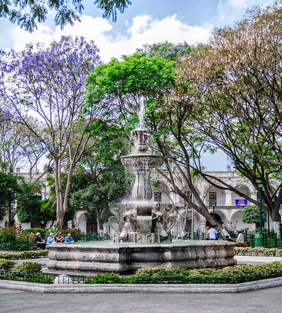 The Fuente de las Sirenas (Fountain of the Sirens) in the center of the Central Plaza (Parque Central), a popular gathering spot the heart of the city of Antigua, Guatemala.