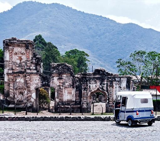Tuk-tuk and ruins in Antigua Guatemala.