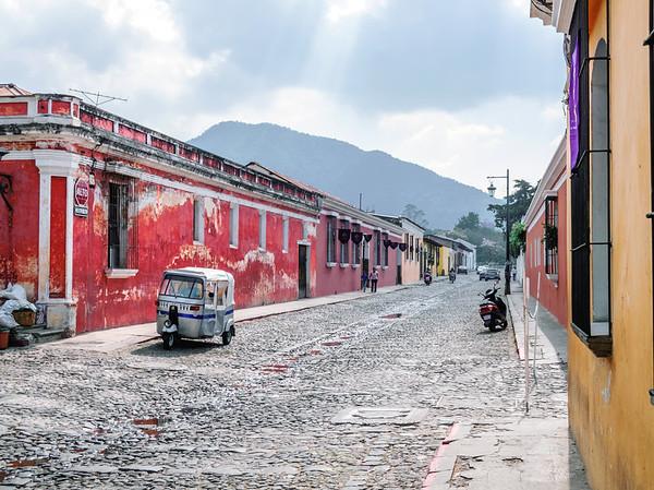 Tuk-tuk taxi in a cobblestone street in Antigua, Guatemala