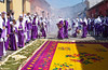 An elaborate street carpet and a Semana Santa procession through the streets of Antigua, Guatemala during Holy week.