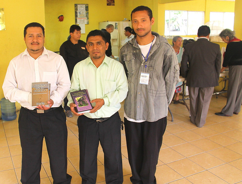 Two sets of Mike Wells books in Spanish were given as gifts for staff members and the library.  All three of these men are graduates of the program, the two on the left are administrators and counselors.  The brother on the right is going home the day after this photo was taken.