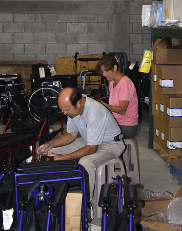 Ron and Susan Naish assembling more wheelchairs and rolling walkers.  They helped me clear one aisle in preparation for the next container.  The Fab Four were a big blessing to Vine International.