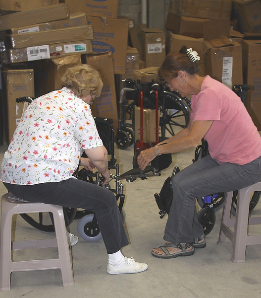 Barbara Banis and Susan Naish figuring out how to put the feet on a wheelchair.  This is from a container recently delivered from Wheels of Hope loaded by volunteers in Alliance Ohio.  Thanks guys and gals.... means more than words can express.