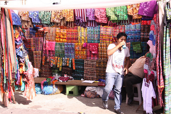hundreds of kiosks selling colorful cloth of all kinds.