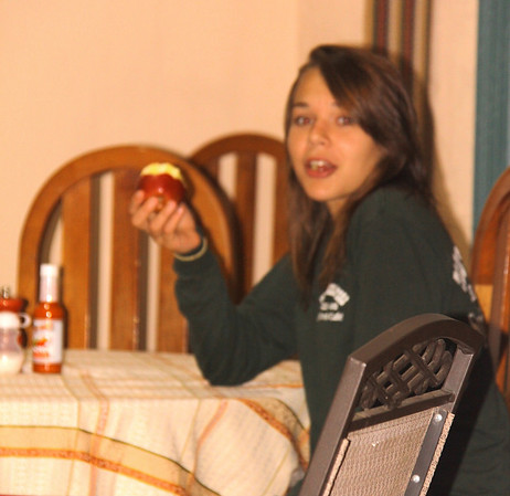 Alyssa with an apple and when she was at the table the hot sauce bottle was never far away.