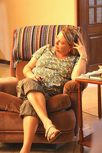 Cindy listening to Claire, chuckle.  Cindy got a real kick having teenage girls in the house once again.