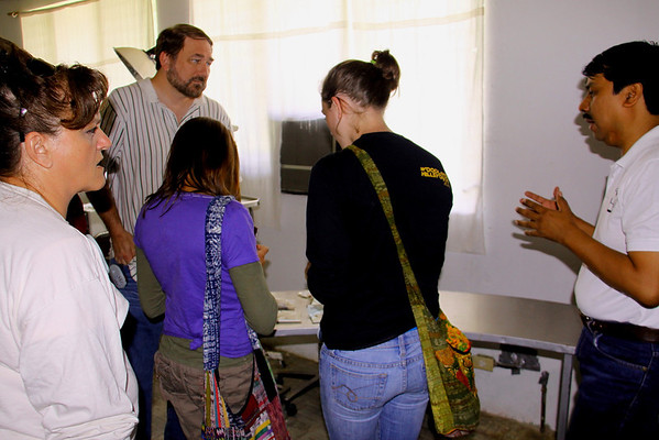 """Touring Hospital Santa Fe with Dr. Sergio Castillo.  He is sharing his """"specimen museum"""" in this photo."""