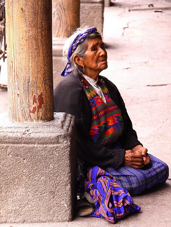 elderly lady begging.  You see a little of this.  but social programs in developing world are often not existing.