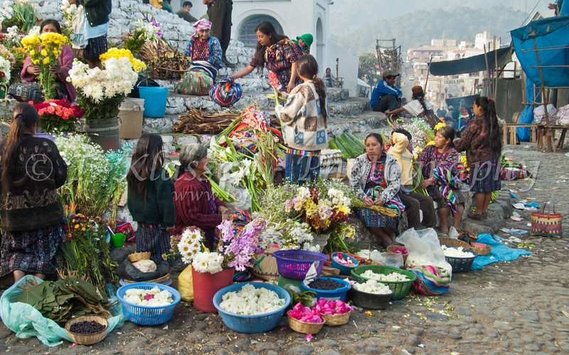 The remowned colorful flower market on the steps of the Santo Tomas church in Chichicastenango, Guatemala, Central America.