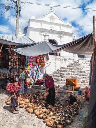 Vendors in front of Church of El Calvario at the Chichicastenango market in Guatemala