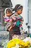 A young mother and child at the flower market on the steps of the Santo Tomas church in Chichicastenango, Guatemala, Central America.