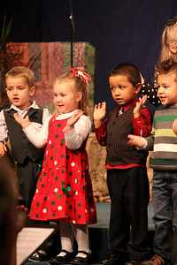 Next day was Olivia's preschool Christmas Pageant.  She was working hard as were all the kids.