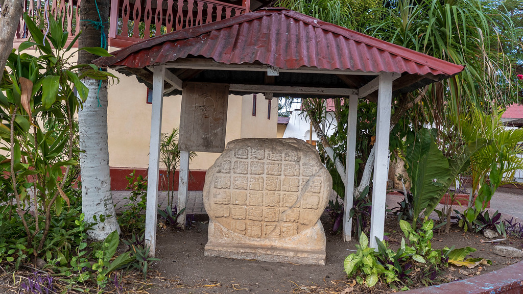 Flores Guatemala: Parque Central Mayan inscriptions on stones