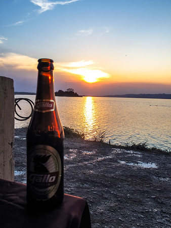 Enjoying a Gallo Cerveza at sunset in Flores, Guatemala
