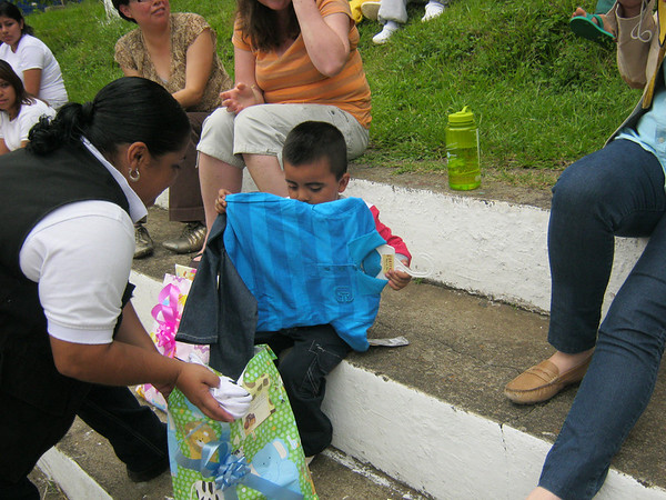 there are four children living with their incarcerated mothers at this young women's prison.  This is the senior warden giving gifts provided by El Barrios for Christ.  More on this little guy later.