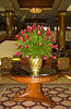 Table and vase with flowers at a downtown Guatemala City Hotel, Guatemala, Central America.