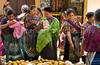 The local market with women shopping for fruit and produce in the village of Santa Maria de Jesus in Guatemala.