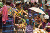 The local market with children and ladies shopping in the village of Santa Maria de Jesus in Guatemala.
