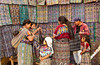 Shoppers at a textile shop at the Comalapa market, Guatemala, Central America.